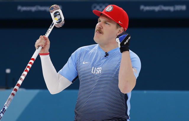 Matt Hamilton celebrates the U.S. men's curling victory over Canada on Monday. (AP)