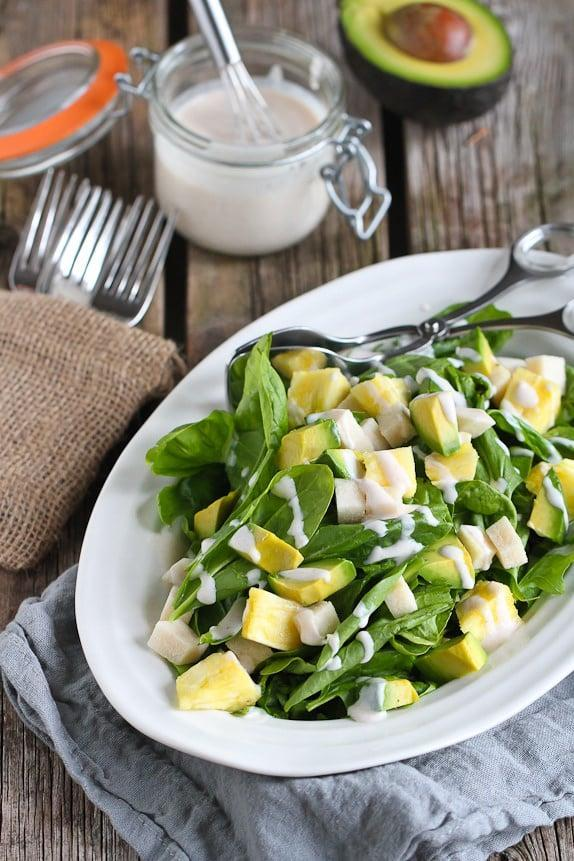 """<p>Take your salad to the next level when you incorporate fresh pineapple into the mix. Juicy and oh-so sweet, this fruit will make your salad shine. To adjust the recipe for two people, just toggle the slider down to the number """"2.""""</p> <p><strong>Get the recipe:</strong> <a href=""""http://www.cookincanuck.com/2015/08/jicama-pineapple-spinach-salad-sriracha-buttermilk-dressing-recipe"""" class=""""link rapid-noclick-resp"""" rel=""""nofollow noopener"""" target=""""_blank"""" data-ylk=""""slk:jicama and pineapple spinach salad"""">jicama and pineapple spinach salad</a></p>"""