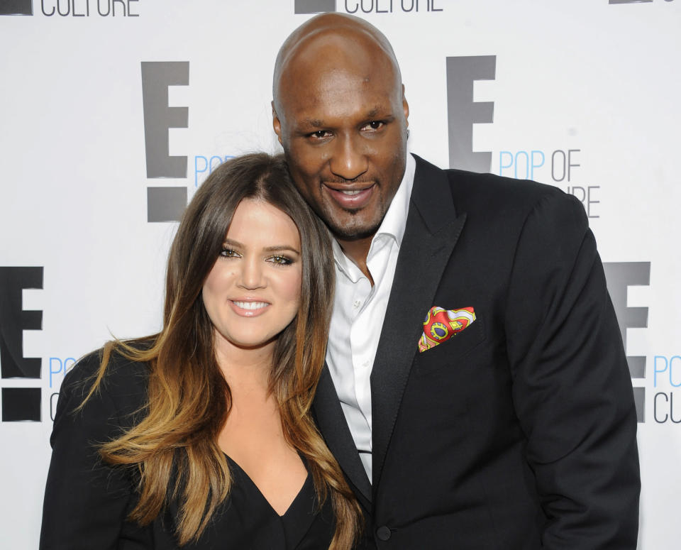 """FILE - In this April 30, 2012, file photo, Khloe Kardashian Odom and Lamar Odom from the show """"Keeping Up With The Kardashians"""" attend an E! Network upfront event at Gotham Hall in New York. A Los Angeles judge on Friday, Dec. 9, 2016, finalized Kardashian and Odom's divorce nearly three years after she first filed to end their marriage. The pair were married in September 2009. (AP Photo/Evan Agostini, File)"""