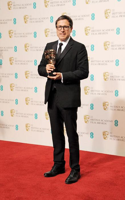 Best Adapted Screenplay winner David O. Russell poses in the Press Room at the EE British Academy Film Awards at The Royal Opera House on February 10, 2013 in London, England. (Photo by Dave M. Benett/Getty Images)