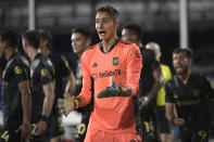 Los Angeles FC goalkeeper Pablo Sisniega argues a call by an official during the first half of an MLS soccer match against the LA Galaxy, Saturday, July 18, 2020, in Kissimmee, Fla. (AP Photo/Phelan M. Ebenhack)