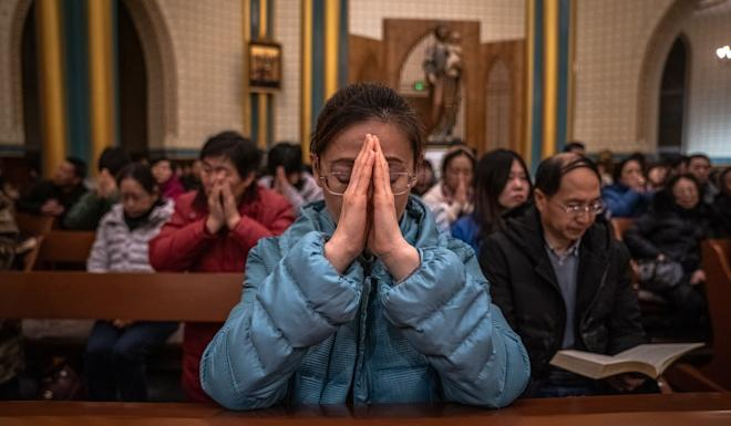 Catholics in China are split between the state-sanctioned church and the unofficial churches faithful to the Vatican. Photo: EPA-EFE
