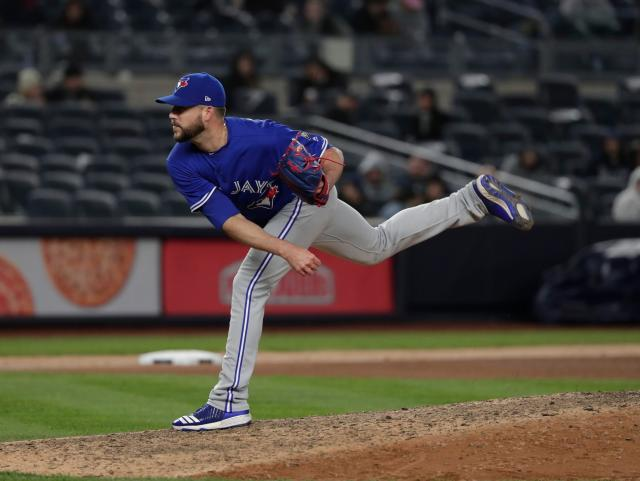 FILE - In this April 20, 2018, file photo, Toronto Blue Jays pitcher Ryan Tepera delivers against the New York Yankees during the eighth inning of a baseball game, in New York. Reliever Ryan Tepera has gone to salary arbitration with the Toronto Blue Jays. Tepera asked for $1.8 million during Wednesday's, Feb. 6, 2019, hearing and the team argued for $1,525,000. A decision by arbitrators Mark Burstein, Howard Edelman and Edna Francis is expected Thursday. (AP Photo/Julie Jacobson, File)