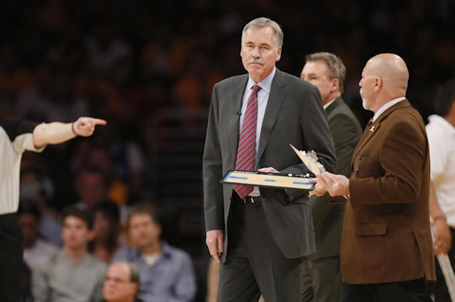 Los Angeles Lakers head coach Mike D'Antoni gets his clipboard from athletic trainer Gary Vitti during a time out against the Oklahoma City Thunder in the first half of an NBA basketball game in Los Angeles, Sunday, March 9, 2014. (AP Photo/Danny Moloshok)