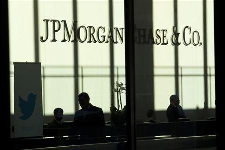 A Twitter banner is seen inside JP Morgan headquarters, before Twitter's IPO in New York