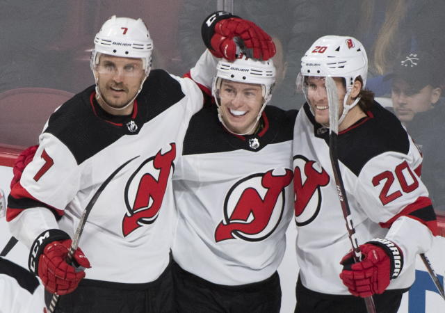 New Jersey Devils' Blake Coleman (20) celebrates with teammates Nikita Gusev and Matt Tennyson (7) after scoring against the Montreal Canadiens during first-period NHL hockey game action in Montreal, Thursday, Nov. 28, 2019. (Graham Hughes/The Canadian Press via AP)