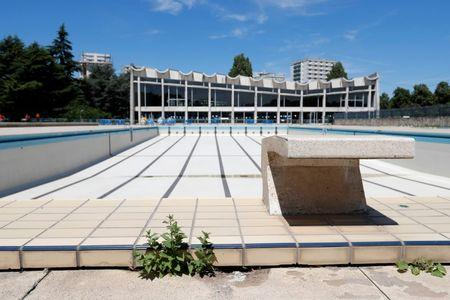 General view of the Marville outdoor swimming pool in Saint-Denis which is part of the Marville sports complex, near Paris, France, July 21, 2017. The complex will undergo renovation for water polo competitions as Paris bids to host the 2024 Olympic and Paralympic Games. Picture taken July 21, 2017.   REUTERS/Charles Platiau