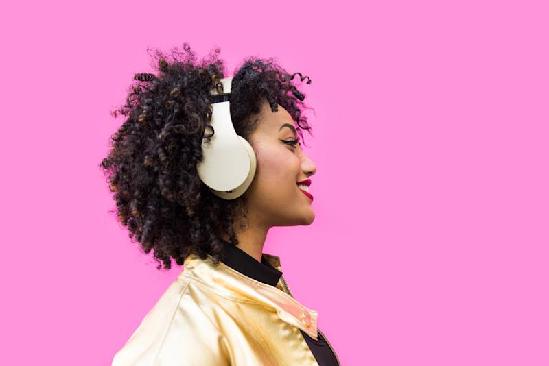 Over-ear noise-cancelling headphones are your safest bet. Photo: Getty Images