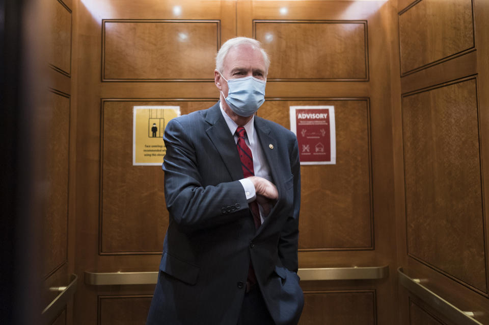 Sen. Ron Johnson, R-Wis., steps into an elevator as the Senate holds a voting marathon on the Democrats' $1.9 trillion COVID-19 relief bill that's expected to end with the chamber's approval of the measure, at the Capitol in Washington, Friday, March 5, 2021. When the Senate took up the measure on Thursday, Johnson forced an extraordinary half-day holdup on the bill by demanding the chamber's clerks read aloud the entire 628-page measure which took 10 hours and 44 minutes and ended shortly after 2 a.m. (AP Photo/J. Scott Applewhite)