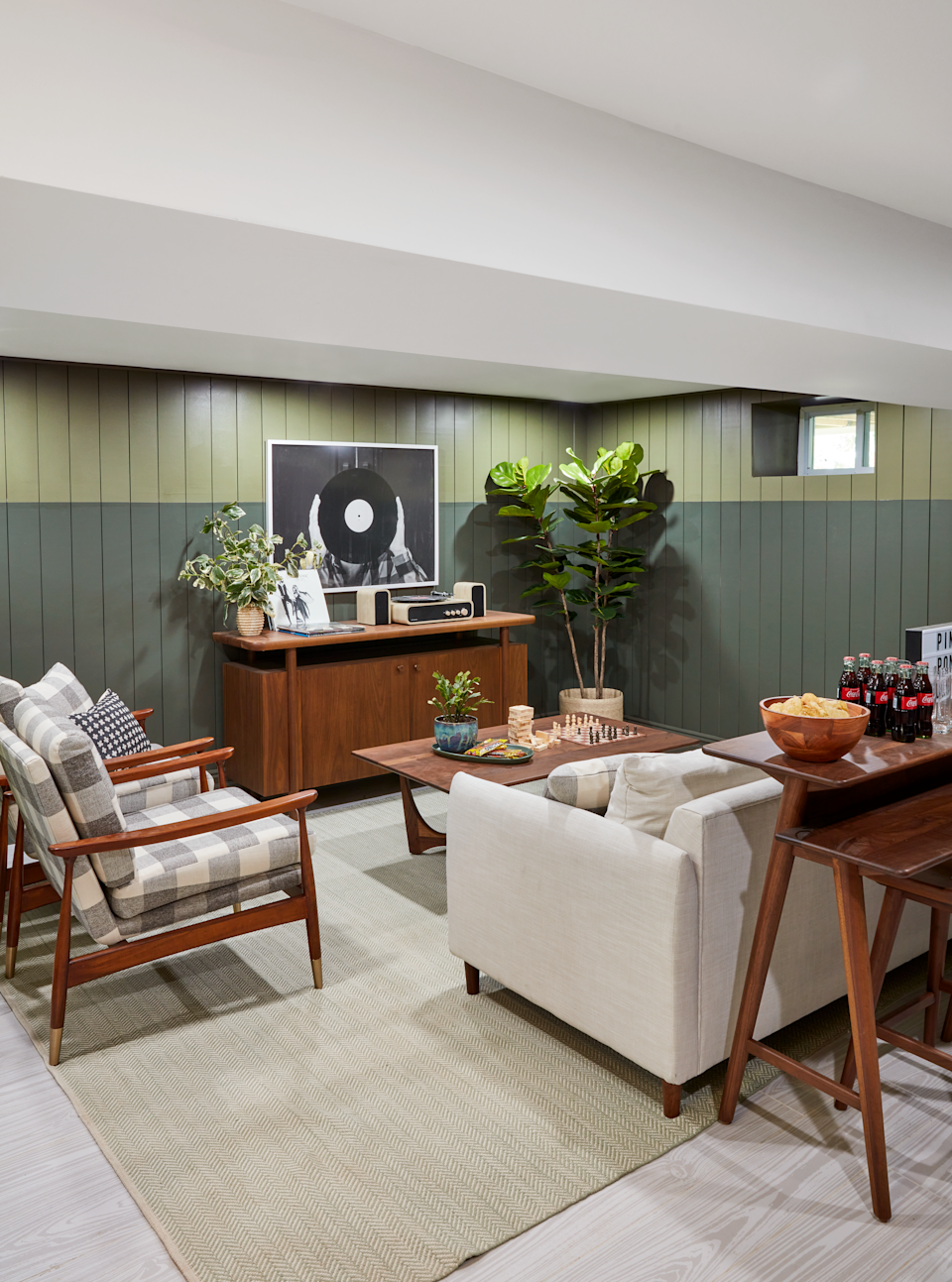 Real Simple Home, Basement Lounge with green walls and sofa