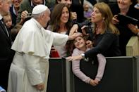 Pope Francis greets a family as he arrives to lead the general audience in Paul VI Hall at the Vatican December 7, 2016. REUTERS/Max Rossi