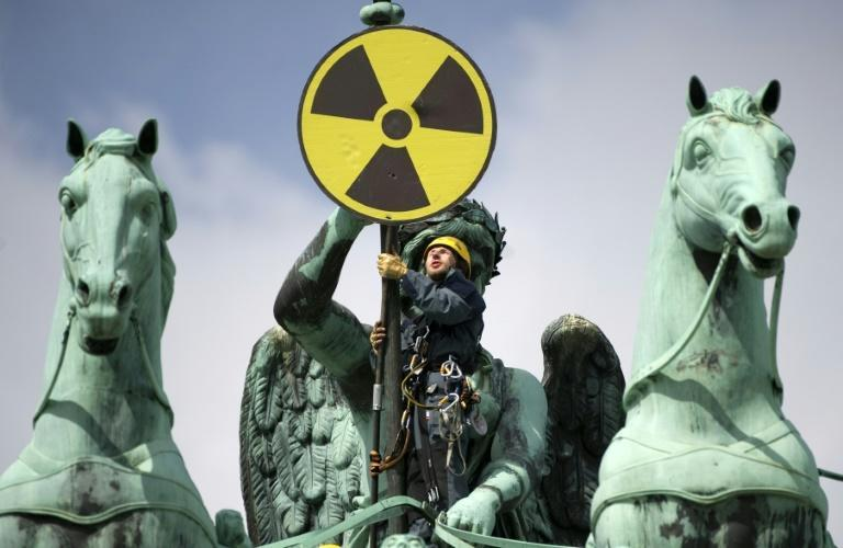 Anti-nuclear groups such as Greenpeace have turned from fears over weapons and waste to economic arguments over efficiency to turn the public against atomic power (AFP/ODD ANDERSEN)