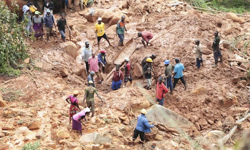 A family dig for their son, who was buried in mud when Cyclone Idai struck Chimanimani in Zimbabwe.