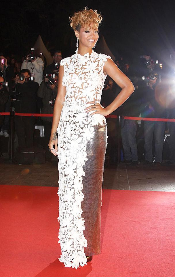 """Meanwhile in the South of France, Rihanna rocked the red carpet at the 11th Annual NRJ Music Awards in an embroidered Jean Paul Gaultier gown, which featured a silver lurex skirt, brilliant baubles, and a super cute coif. KCSPresse/<a href=""""http://www.splashnewsonline.com"""" target=""""new"""">Splash News</a> - January 23, 2010"""