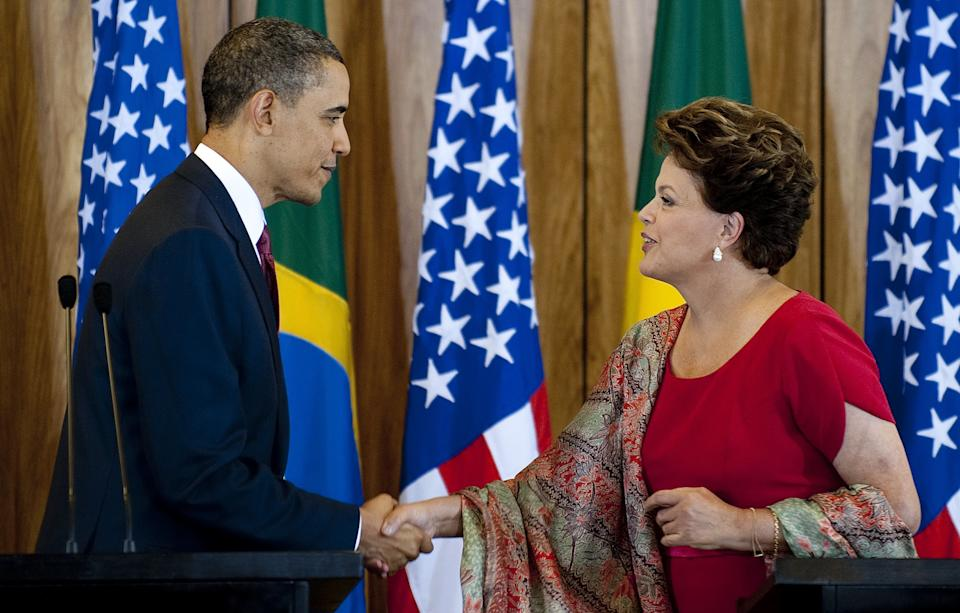 U.S. President Barack Obama shakes hands with Brazilian President Dilma Vana Rousseff during a joint press conference at Palacio do Planalto in Brasilia on March 19, 2011.
