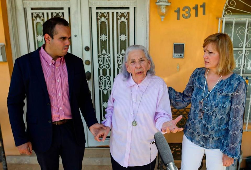 Ana Lazara Rodriguez, 82, center, surrounded by Eleazar Melendez, left, and Laura Wagner, right, speaks during a press conference outside of her home in Miami, Florida on Thursday, May 6, 2021.