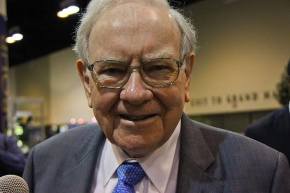 Warren Buffett smiles at the camera.