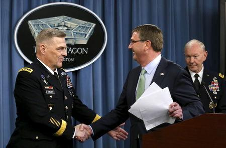 Defense Secretary Ash Carter (R) greets Army General Mark Milley at the Pentagon Briefing Room