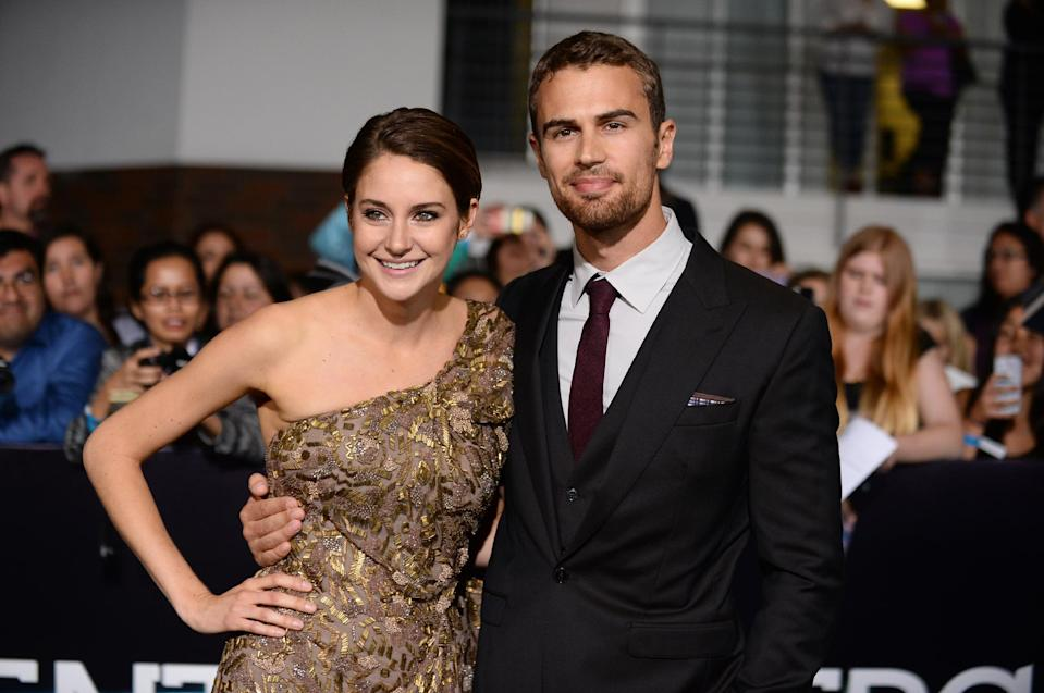 """In this Tuesday, March 18, 2014 file photo, Shailene Woodley, left, and Theo James arrive at the world premiere of """"Divergent"""" at the Westwood Regency Village Theater in Los Angeles. The soulful Brit James, the co-star of the buzzed about """"Divergent,"""" is being set up as Hollywood next heartthrob. The film adaptation of Veronica Roth's sci-fi best-seller hits theaters on Friday, March 21, 2014. (Photo by Jordan Strauss/Invision/AP, file)"""