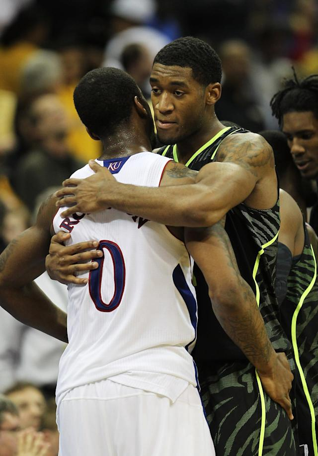 KANSAS CITY, MO - MARCH 09: Perry Jones III #1 of the Baylor Bears and Thomas Robinson #0 of the Kansas Jayhawks embrace after the Bears defeated the Jayhawks 81 to 72 during the semifinals of the 2012 Big 12 Men's Basketball Tournament at Sprint Center on March 9, 2012 in Kansas City, Missouri. (Photo by Jamie Squire/Getty Images)