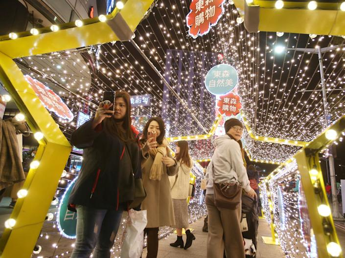 People in Taiwan view lanterns on display for the Chinese lunar new year, in Taipei, Taiwan, February 9, 2020. (AP Photo  Chiang Ying ying)