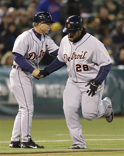 Detroit Tigers' Prince Fielder, right, is congratulated by third base coach Tom Brookens after hitting a three-run home run off Oakland Athletics' Bartolo Colon in the third inning of a baseball game on Friday, April 12, 2013, in Oakland, Calif. (AP Photo/Ben Margot)