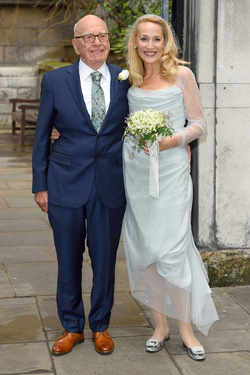 "<p>Instead of wearing white (technically it was her first wedding, since her 1990 nuptials to Mick Jagger were annulled), the model and actress wore a light blue <span class=""redactor-unlink"">Vivienne Westwood</span> dress. </p>"
