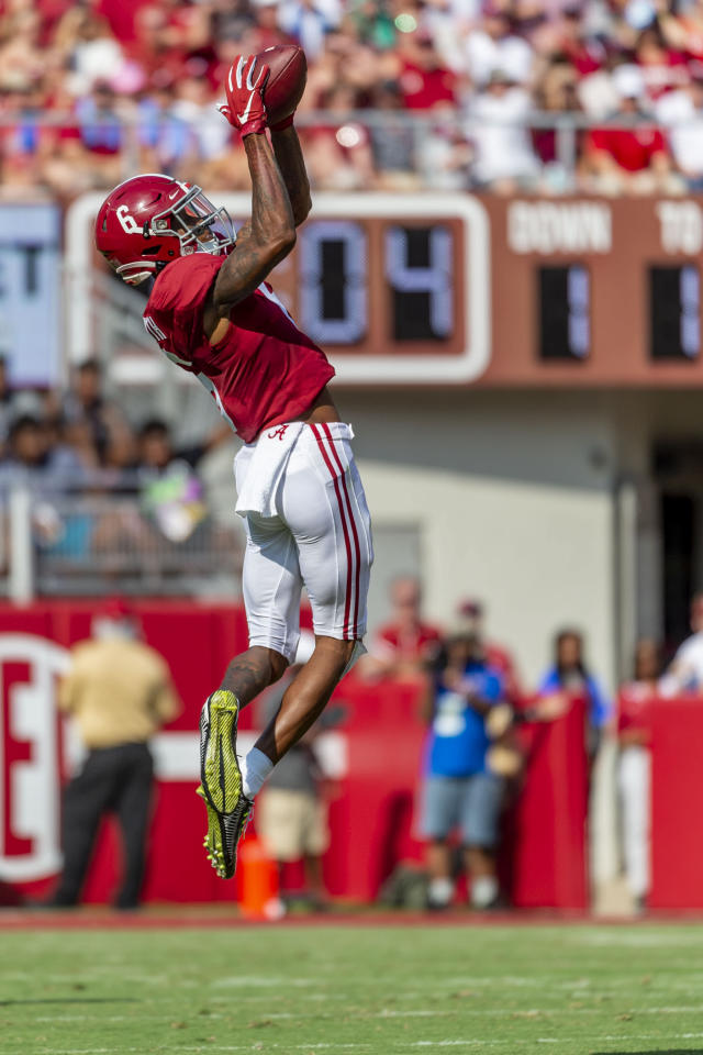 Alabama wide receiver DeVonta Smith (6) makes a leaping catch of a pass from quarterback Tua Tagovailoa during the first half of an NCAA college football game against Mississippi, Saturday, Sept. 28, 2019, in Tuscaloosa, Ala. (AP Photo/Vasha Hunt)