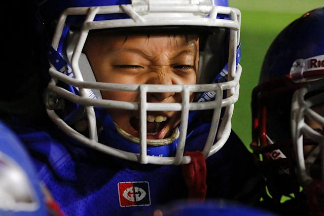 <p>A Sharklets player reacts as he plays the Eagles during their Future League American football youth league match in Beijing, May 26, 2017. (Photo: Thomas Peter/Reuters) </p>