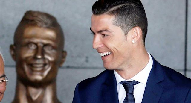 """Renaming the Madeira airport after <a class=""""link rapid-noclick-resp"""" href=""""/soccer/players/ronaldo-391918"""" data-ylk=""""slk:Ronaldo"""">Ronaldo</a> obviously was much, much easier. (Reuters)"""