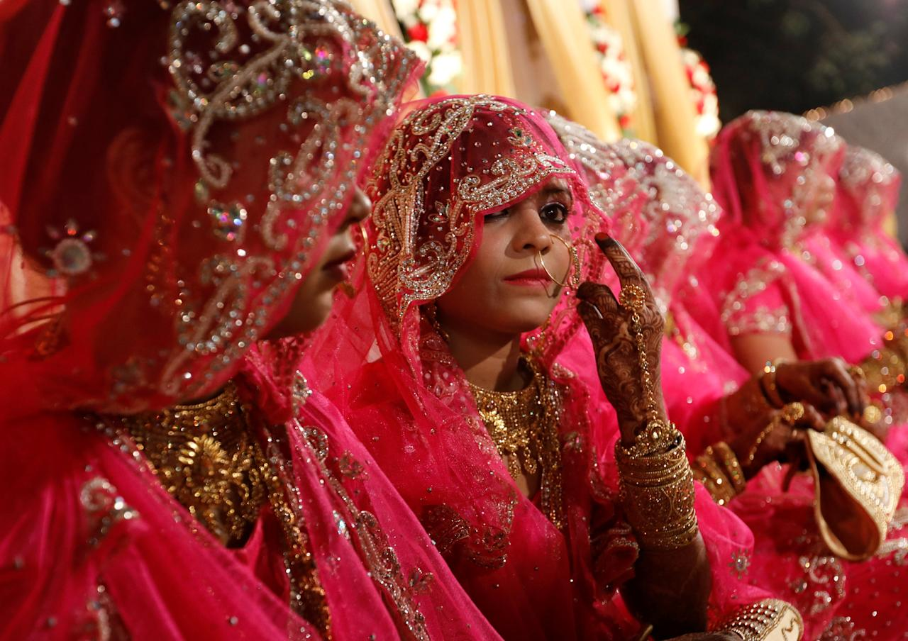 Muslim brides wait for the start of a mass marriage ceremony in Mumbai, India, November 20, 2017. REUTERS/Danish Siddiqui