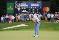 Patrick Cantlay putts on the forth green during the final round of the BMW Championship golf tournament, Sunday, Aug. 29, 2021, at Caves Valley Golf Club in Owings Mills, Md. (AP Photo/Julio Cortez)