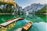 <p>Docked rowboats sit in the clear waters of Lake Braies in Dolomites, Sudtirol, Italy.</p>