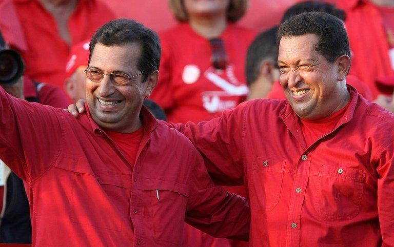 Venezuela's President Hugo Chavez (R) participates in a rally with his brother Adan in Barinas on November 15, 2008
