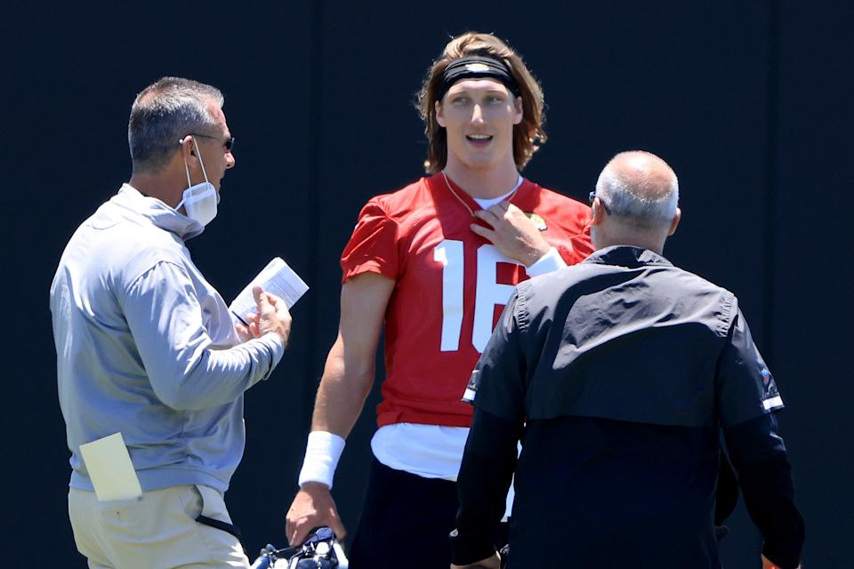 Jaguars head coach Urban Meyer speaks with Trevor Lawrence during rookie camp on May 15 in Jacksonville, Florida. (Photo by Sam Greenwood/Getty Images)