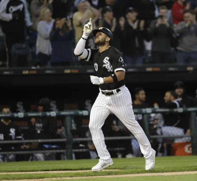 Chicago White Sox's Yoan Moncada celebrates his three-run home run off Baltimore Orioles starting pitcher Alex Cobb during the third inning of a baseball game Wednesday, May 23, 2018, in Chicago. Tim Anderson and Adam Engel also scored on the play. (AP Photo/Charles Rex Arbogast)