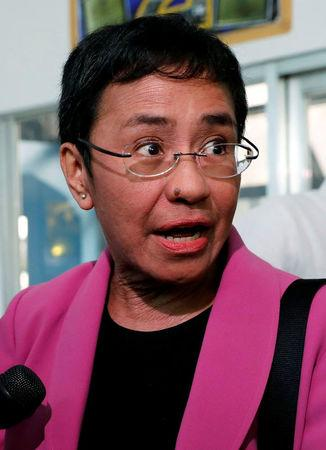 Rappler CEO Maria Ressa speaks to members of the media at the National Bureau of Investigation (NBI) on Taft avenue in metro Manila
