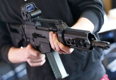 A man holds a G 36 KA rifle manufactured by Heckler & Koch during a guided media tour at arms factory Heckler & Koch in Oberndorf, 80 kilometers southwest of Stuttgart, Germany, May 8, 2015. REUTERS/Ralph Orlowski