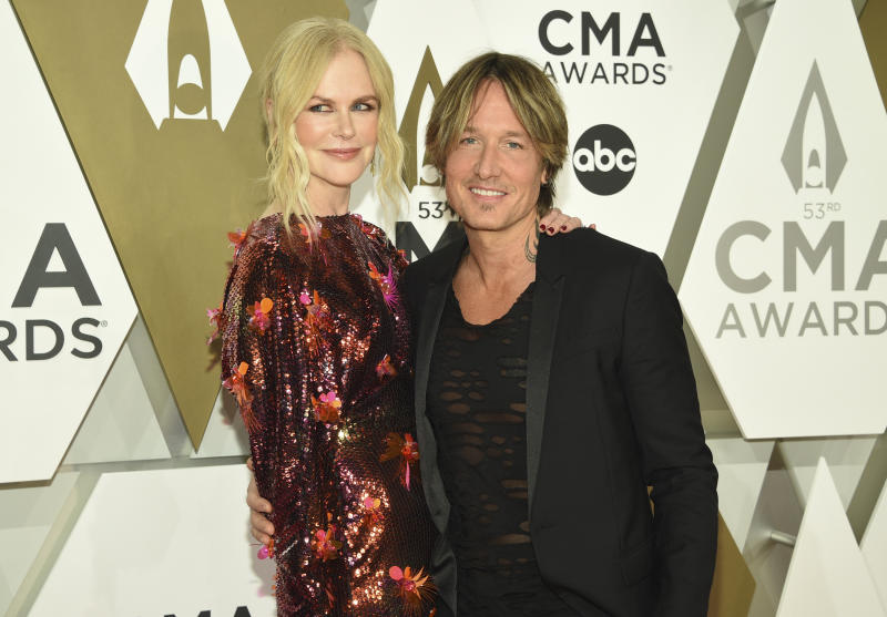 Nicole Kidman, left, and Keith Urban arrive at the 53rd annual CMA Awards at Bridgestone Arena on Wednesday, Nov. 13, 2019, in Nashville, Tenn. (Photo by Evan Agostini/Invision/AP)