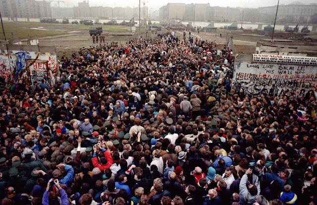 East Berliners cross and meet West Berliners at Potsdamer Platz after the Berlin Wall was torn down, making way for a new border crossing on Nov. 12, 1989. (Photo: Wolfgang Rattay/Reuters)