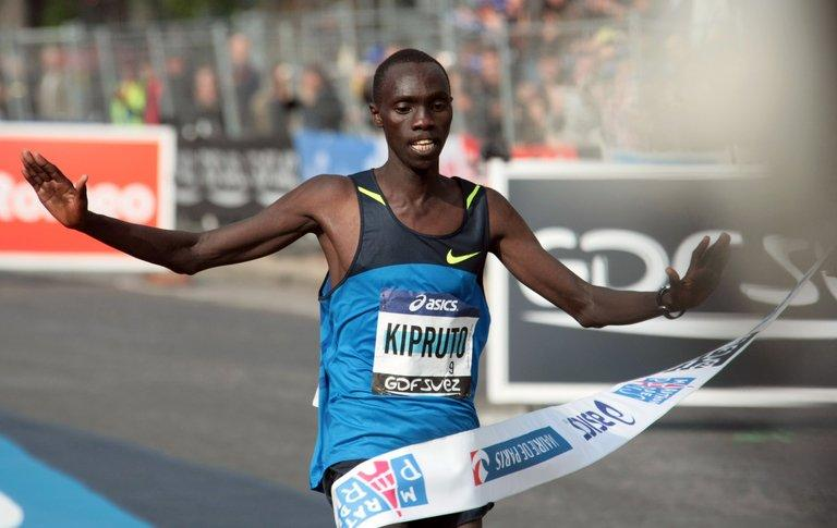 Kenya's Vincent Kipruto is pictured crossing the finish line at the Paris Marathon on April 5, 2009