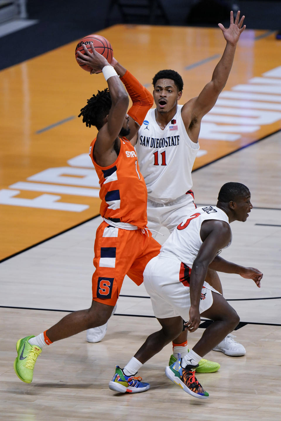 San Diego State forward Matt Mitchell (11) defends against Syracuse forward Quincy Guerrier during the first half of a college basketball game in the first round of the NCAA tournament at Hinkle Fieldhouse in Indianapolis, Friday, March 19, 2021. (AP Photo/AJ Mast)