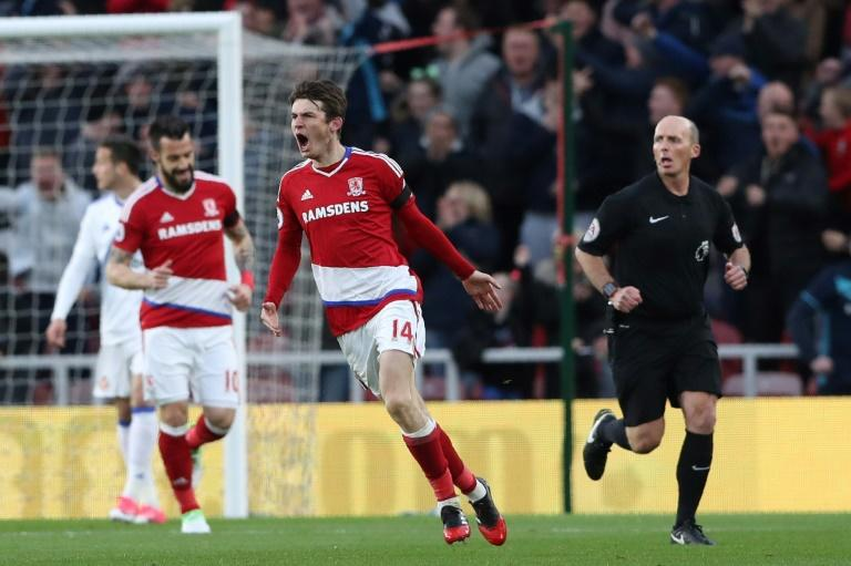 Middlesbrough's Dutch midfielder Marten de Roon (C) celebrates after scoring the opening goal of the English Premier League football match against Sunderland April 26, 2017