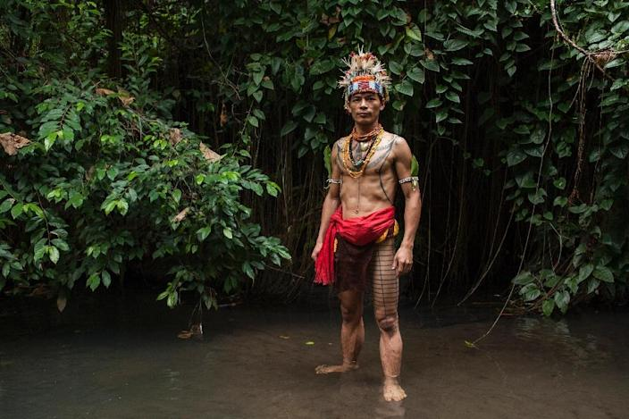 Esmat Sakulok shows off his body tattoo design from the Mentawai tribe origin during a traditional tattoo festival in the village of Maguwoharjo in Yogyakarta (AFP Photo/Suryo Wibowo)