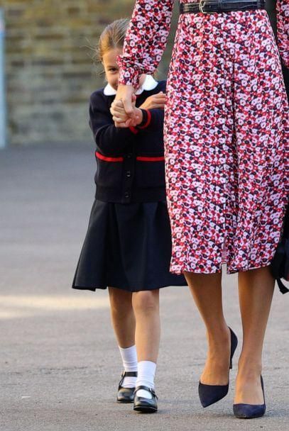 PHOTO:Princess Charlotte hides behind her mother as she arrives for her first day of school at Thomas's Battersea in London, Sept. 5, 2019. (REX via Shutterstock)