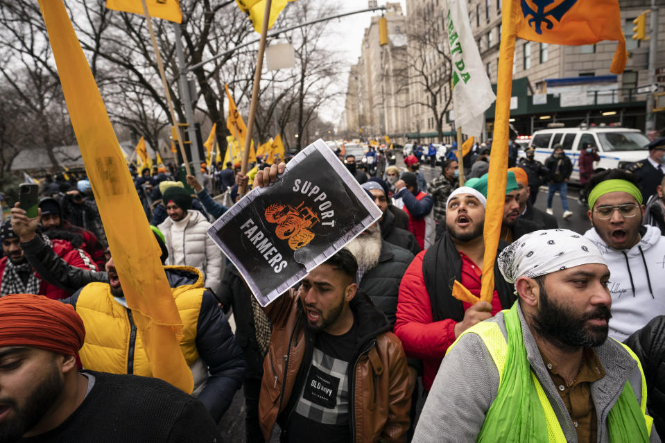 Protesters lead a chant while gathering on Fifth Avenue outside the Consulate General of India, Tuesday, Jan. 26, 2021, in the Manhattan borough of New York. Tens of thousands of protesting farmers have marched, rode horses and drove long lines of tractors into India's capital, breaking through police barricades to storm the historic Red Fort. The farmers have been demanding the withdrawal of new laws that they say will favor large corporate farms and devastate the earnings of smaller scale farmers. Republic Day marks the anniversary of the adoption of India's constitution on Jan. 26, 1950. (AP Photo/John Minchillo)