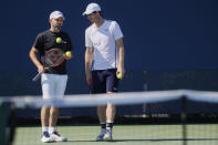Andy Murray, right, of Britain, speaks to his coach Jamie Delgado, left, at the Western & Southern Open tennis tournament, Sunday, Sunday, Aug. 11, 2019, in Mason, Ohio. (AP Photo/John Minchillo)