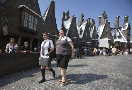 Guests tour the Wizarding World of Harry Potter theme park in Orlando, Florida