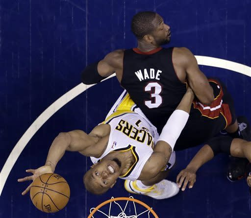 Indiana Pacers' David West (21) puts up a shot against Miami Heat's Dwyane Wade (3) during the second half Game 3 of the NBA Eastern Conference basketball finals in Indianapolis, Sunday, May 26, 2013. (AP Photo/Michael Conroy)