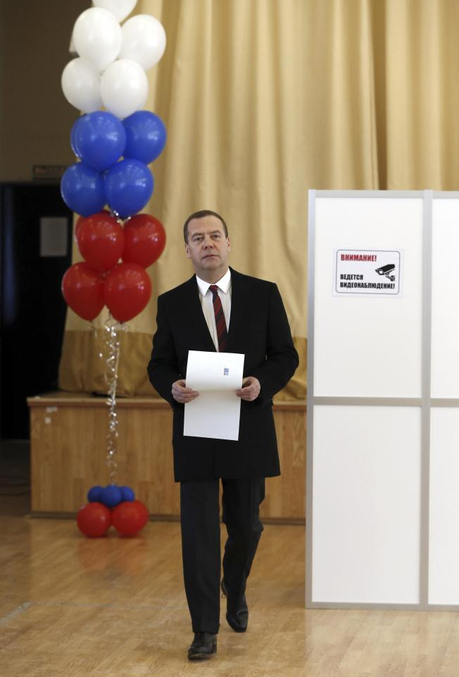 Russian Prime Minister Dmitry Medvedev holds a ballot before casting his vote at a polling station during the presidential election in Moscow, Russia March 18, 2018. Sputnik/Dmitry Astakhov/Pool via REUTERS  ATTENTION EDITORS - THIS IMAGE WAS PROVIDED BY A THIRD PARTY.